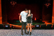 """Olympian Ryan Lochte (L) and dancer Cheryl Burke stand in the """"O"""" theater during a rehearsal for their """"Dancing with the Stars"""" performance with the cast of """"O by Cirque du Soleil"""" at the Bellagio on September 30, 2016 in Las Vegas, Nevada."""