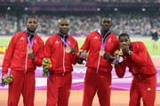 Bronze medalists Richard Thompson, Emmanuel Callender, Marc Burns  and Keston Bledman of Trinidad and Tobago celebrate on the podium during the medal ceremony for the Men's 4 x 100m Relay Final on Day 15 of the London 2012 Olympic Games at Olympic Stadium on August 11, 2012 in London, England.