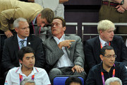 Arnold Schwarzenegger (C) and London Mayor Boris Johnson (R) during the Men's Basketball gold medal game between the United States and Spain on Day 16 of the London 2012 Olympics Games at North Greenwich Arena on August 12, 2012 in London, England.