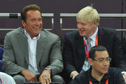 Arnold Schwarzenegger (L) and London Mayor Boris Johnson talk during the Men's Basketball gold medal game on Day 16 of the London 2012 Olympics Games at North Greenwich Arena on August 12, 2012 in London, England.