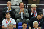 Arnold Schwarzenegger watches the action (C) whilst London Mayor Boris Johnson (R) takes a phone callduring the Men's Basketball gold medal game between the United States and Spain on Day 16 of the London 2012 Olympics Games at North Greenwich Arena on August 12, 2012 in London, England.
