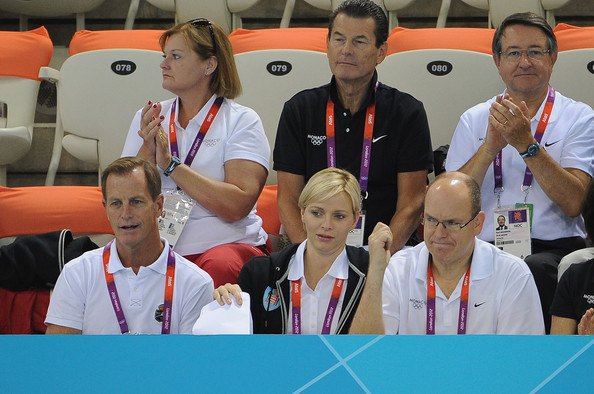 (L-R) Christopher Le Vine, Princess Charlene and Prince Albert II of Monaco attend the swimming competitions at Aquatics Centre on July 29, 2012 in London, England.