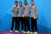 (L-R) Silver medallists Nathan Adrian, Michael Phelps, Cullen Jones and Ryan Lochte of the United States pose on the podium during the medal ceremony following the Men's 4 x 100m Freestyle Relay final on Day 2 of the London 2012 Olympic Games at the Aquatics Centre on July 29, 2012 in London, England.