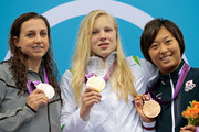 (L-R) Silver medalist Rebecca Soni of the United State, gold medalist Ruta Meilutyte of Lithuania and bronze medalist Satomi Suzuki of Japan celebrate with their medals during the medal ceremony for the Women's 100m Breaststroke on Day 3 of the London 2012 Olympic Games at the Aquatics Centre on July 30, 2012 in London, England.