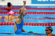Ruta Meilutyte of Lithuania celebrates after she won the Final of the Women's 100m Breaststroke as Rebecca Soni of the United States looks on on Day 3 of the London 2012 Olympic Games at the Aquatics Centre on July 30, 2012 in London, England.