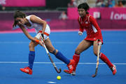 Aki Mitsuhashi of Japan (R) and Naomi van As of Netherlands compete for the ball during the Women's Hockey Match between the Netherlands and Japan on day 4 of the London 2012 Olympic Games at Hockey Centre on July 31, 2012 in London, England.