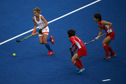 Ellen Hoog (L) of the Netherlands is surrounded by the Japan defense during the Women's Hockey Match between the Netherlands and Japan on day 4 of the London 2012 Olympic Games at Hockey Centre on July 31, 2012 in London, England.