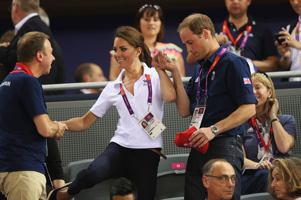 Catherine, Duchess of Cambridge is helped to her seat by Prince William, Duke of Cambridge and Andy Hunt, Chef de Mission for Great Britain as they watch the track cycling on Day 6 of the London 2012 Olympic Games at Velodrome on August 2, 2012 in London, England.