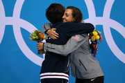 Silver medallist Satomi Suzuki of Japan hugs gold medallist Rebecca Soni of the United States during the medal ceremony for the Women's 200m Breaststroke Final on Day 6 of the London 2012 Olympic Games at the Aquatics Centre on August 2, 2012 in London, England.