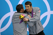 Gold medallist Michael Phelps (R) of the United States hugs Silver medallist Ryan Lochte of the United States on the podium during the medal ceremony for the Men's 200m Individual Medley final on Day 6 nof the London 2012 Olympic Games at the Aquatics Centre on August 2, 2012 in London, England.