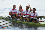 Tim Grohmann, Lauritz Schoof, Phillipp Wende and Karl Schulze of Germany celebrate in their boat with their gold medals during the medal ceremony for the Men's Quadruple Sculls final on Day 7 of the London 2012 Olympic Games at Eton Dorney on August 3, 2012 in Windsor, England.