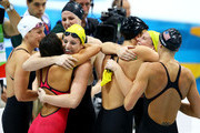 Alicia Coutts, Emily Seebohm, and Leisel Jones of Australia congratulate winners Dana Vollmer, Missy Franklin, Allison Schmitt, and Rebecca Soni of the United States following the Women's 4x100m Medley Relay on Day 8 of the London 2012 Olympic Games at the Aquatics Centre on August 4, 2012 in London, England.