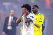 Luiz Gustavo and Steve Mandanda of Marseille walk off dejected after the UEFA Europa League Final between Olympique de Marseille and Club Atletico de Madrid at Stade de Lyon on May 16, 2018 in Lyon, France.