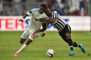 Bouna Sarr (L) of Olympique de Marseille competes with Patrice Evra of Juventus FC during the preseason friendly match between Olympique de Marseille and Juventus FC at Stade Velodrome on August 1, 2015 in Marseille, France.