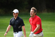Actor Dennis Quaid walks with Rory McIlroy of Northern Ireland during the pro-am prior to the start of the Omega European Masters at Crans Montana Golf Club on August 28, 2019 in Crans-Montana, Switzerland.