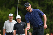 Singer Justin Timberlake of USA and Rory McIlroy of Northern Ireland discuss a putt during the pro-am prior to the start of the Omega European Masters at Crans Montana Golf Club on August 28, 2019 in Crans-Montana, Switzerland.