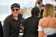 """(L-R) Brad Pitt, Quentin Tarantino and Margot Robbie  attend thephotocall for """"Once Upon A Time In Hollywood""""  during the 72nd annual Cannes Film Festival on May 22, 2019 in Cannes, France."""