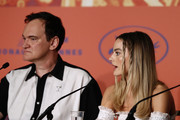 """Director Quentin Tarantino and Margot Robbie attend the """"Once Upon A Time In Hollywood"""" Press Conference during the 72nd annual Cannes Film Festival on May 22, 2019 in Cannes, France."""