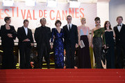 (L-R)  Producer Lene Borglum, musician Cliff Martinez, actors Vithaya Pansringarm, Kristin Scott Thomas,, director Nicolas Winding Refn and is wife Liv Corfixen, actors Rhatha Phongam and Matthew Newman attend the 'Only God Forgives' Premiere during the 66th Annual Cannes Film Festival at Palais des Festivals on May 22, 2013 in Cannes, France.