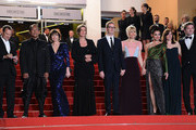 (L-R) Musician Cliff Martinez, actors Vithaya Pansringarm, Kristin Scott Thomas, producer Lene Borglum, director Nicolas Winding Refn and is wife Liv Corfixen, actors Rhatha Phongam and Matthew Newman attend the 'Only God Forgives' Premiere during the 66th Annual Cannes Film Festival at Palais des Festivals on May 22, 2013 in Cannes, France.