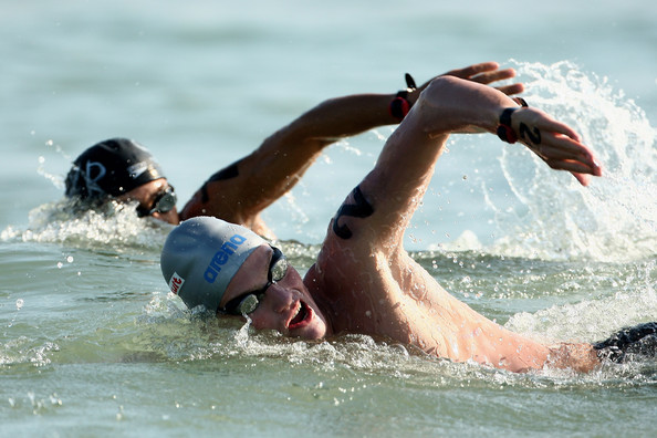 Libor Smolka of the Czech Republic and Saleh Mohammad of Syria swim in the Men's 25 Km Open Water Swimming during the 13th FINA World Championships at Ostia Beach on July 25, 2009 in Rome, Italy.