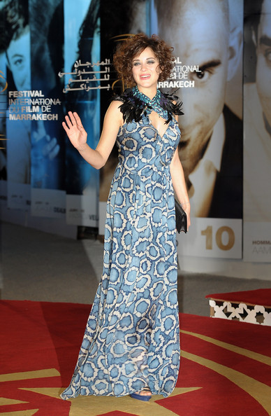 Actress Marion Cotillard Poses as she arrives at the Opening Ceremony of the Marrakech 10th International Film Festival on December 3, 2010 in Marrakech, Morocco.