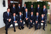 (L-R) Back Row; Lee Westwood, Padraig Harrington, Ross Fisher, Peter Hanson, Martin Kaymer, Ian Poulter, Miguel Angel Jimenez; Front Row; Lee Westwood, Graeme McDowell, Luke Donald, Team Captain Colin Montgomerie, Edoardo Molinari, Francesco Molinari and Rory McIlroy pose prior to the Opening Ceremony prior to the 2010 Ryder Cup at the Celtic Manor Resort on September 30, 2010 in Newport, Wales.
