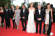 (3L-R) Jury Members Mahamat-Saleh Haroun, Olivier Assayas, Linn Ullmann, Johnnie To, Uma Thurman, Jury President Robert De Niro, and Member Martina Gusmanattend the Opening Ceremony at the Palais des Festivals during the 64th Cannes Film Festival on May 11, 2011 in Cannes, France.