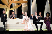 (front row L-R) President of the Main competition jury Alejandro Gonzalez Inarritu, Jury Members Elle Fanning, wearing Chopard jewels, Pawel Pawlikowski and Maimouna N'Diaye, (back row L-R) Robin Campillo, Alice Rohrwacher, Yorgos Lanthimos, Kelly Reichardt and Enki Bilal attend the Opening Ceremony during the 72nd annual Cannes Film Festival on May 14, 2019 in Cannes, France.