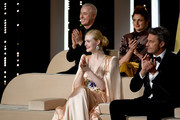 (front row) Jury Member Elle Fanning, wearing Chopard jewels, Jury Members Pawel Pawlikowski, (back row) Robin Campillo and Alice Rohrwacher attends the Opening Ceremony during the 72nd annual Cannes Film Festival on May 14, 2019 in Cannes, France.