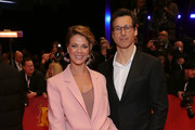 """(L-R) Jessica Schwarz and Florian David Fitz arrive for the opening ceremony and """"My Salinger Year"""" premiere during the 70th Berlinale International Film Festival Berlin at Berlinale Palace on February 20, 2020 in Berlin, Germany."""