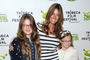 """TV personality Kelly Bensimon (C) with daughters Sea Louise Bensimon (L) and Thaddeus Ann Bensimon (R) at the 2010 Tribeca Film Festival opening night premiere of """"Shrek Forever After"""" at the Ziegfeld Theatre on April 21, 2010 in New York City."""