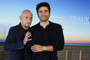 """Sir Ben Kingsley and Oscar Isaac attend a photocall for """"Operation Finale"""" on September 8, 2018 in Deauville, France."""