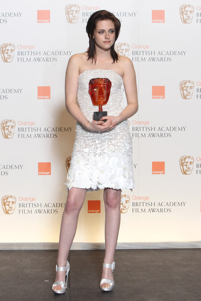 (UK TABLOID NEWSPAPERS OUT) Kristen Stewart poses with her Orange rising star award in front of the winners boards at the Orange British Academy Film Awards held at The Royal Opera House on February 21, 2010 in London, England.