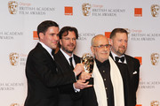 Special Visual Effects award winners Tim Burke, John Richardson, Greg Butler and David Vickery pose in the press room during the Orange British Academy Film Awards 2012 at the Royal Opera House on February 12, 2012 in London, England.