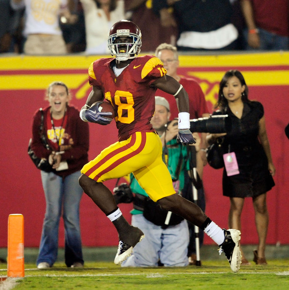 Damian Williams #18 of the USC Trojans returns a 63-yard punt return for a touchdown against Oregon State Beavers during the fourth quarter of the college football game at Los Angeles Memorial Coliseum on October 24, 2009 in Los Angeles, California.