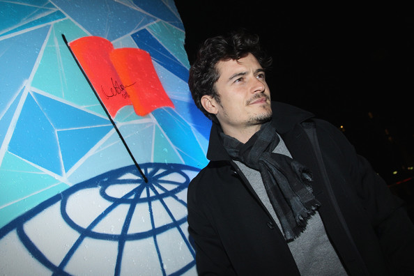 Orlando Bloom Actor Orlando Bloom turns after signing a piece of the former Berlin Wall upon his arrival at the Cinema For Peace Green Evening 2010 at the China Club on November 12, 2010 in Berlin, Germany.