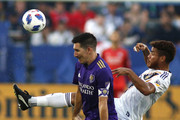 Sacha Kljestan #16 of Orlando City SC and Jonathan dos Santos #8 of the Los Angeles Galaxy fight for control of the ball at StubHub Center on July 29, 2018 in Carson, California.