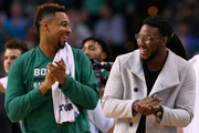 Jae Crowder #99 of the Boston Celtics laughs with Jared Sullinger #7 during a time out during the second quarter against the Orlando Magic at TD Garden on March 21, 2016 in Boston, Massachusetts.
