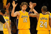 Pau Gasol #16 and Kobe Bryant #24 of the Los Angeles Lakers celebrate after a play in the fourth quarter during the game against the Orlando Magic on January 18, 2010 at Staples Center in Los Angeles, California. NOTE TO USER: User expressly acknowledges and agrees that, by downloading and/or using this Photograph, user is consenting to the terms and conditions of the Getty Images License Agreement.