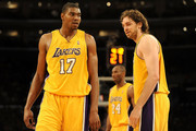 (L-R) Andrew Bynum #17, Kobe Bryant #24 and Pau Gasol #16 of the Los Angeles Lakers stand on the court in the second quarter during the game against the Orlando Magic on January 18, 2010 at Staples Center in Los Angeles, California. NOTE TO USER: User expressly acknowledges and agrees that, by downloading and/or using this Photograph, user is consenting to the terms and conditions of the Getty Images License Agreement.