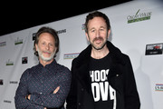 (L-R) Steven Weber and Chris O'Dowd attend the Oscar Wilde Awards 2020 at Bad Robot on February 06, 2020 in Santa Monica, California.