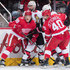 Tyler Bertuzzi #59 and Henrik Zetterberg #40 of the Detroit Red Wings battle along the boards with Nate Thompson #17 and Tom Pyatt #10 of the Ottawa Senators during an NHL game at Little Caesars Arena on January 3, 2017 in Detroit, Michigan. - 2 of 4