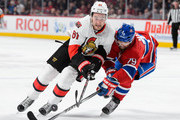 Mark Stone #61 of the Ottawa Senators and Andrei Markov #79 of the Montreal Canadiens skate for the puck during the NHL game at the Bell Centre on December 12, 2015 in Montreal, Quebec, Canada.  The Montreal Canadiens defeated the Ottawa Senators 3-1.