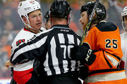 Chris Neil #25 of the Ottawa Senators is held back as Ryan White #25 of the Philadelphia Flyers gets in a few words in the third period at the Wells Fargo Center on April 2, 2016 in Philadelphia, Pennsylvania.The Philadelphia Flyers defeated the Ottawa Senators 3-2.