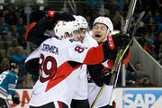 Max McCormick #89 of the Ottawa Senators is congratulated by Cody Ceci #5 and Chris Neil #25 after he scored a goal on Alex Stalock #32 of the San Jose Sharks in the first period at SAP Center on January 18, 2016 in San Jose, California.