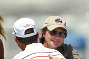 Actor Michael J. Fox (R) talks with Chip Beck during the first round of the Outback Steakhouse Pro-Am at TPC Tampa Bay on April 15, 2011 in Lutz, Florida.