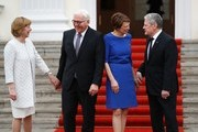 Germany's outgoing President Joachim Gauck (R) and his partner Daniela Schadt (L) welcome his successor Frank-Walter Steinmeier and his wife Elke Buedenbender ahead of the handover ceremony at the presidential Bellevue palace in Berlin on March 19, 2017.  / AFP PHOTO / Odd ANDERSEN