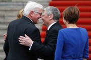 Germany's outgoing President Joachim Gauck (2ndR) welcome his successor Frank-Walter Steinmeier (2ndL) as their partners Daniela Schadt (L) and Elke Buedenbender (R) watch ahead of the handover ceremony at the presidential Bellevue palace in Berlin on March 18, 2017.  / AFP PHOTO / Odd ANDERSEN