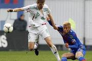 Keisuke Honda (R) of PFC CSKA Moscow in action against Oleg Ivanov of FC Terek Grozny during the Russian Premier League match between PFC CSKA Moscow and FC Terek Grozny at the Arena Khimki Stadium on May 04, 2013 in Khimki, Russia.